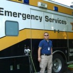 EHS intern in front of ambulance